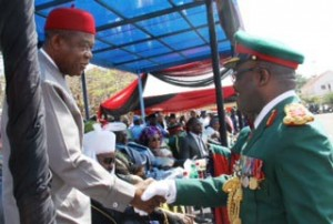 Abia State Governor, T.A Orji, in a handshake with Air Chief Marshal A. S. Badeh, during the farewell activities in honour of immediate past Chief of Army Staff, Gen. O.A. Ihejirika, held at Parade Ground Mogadishu Cantonment, Asokoro,  Abuja.