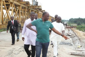 Rivers State Governor, Rt. Hon. Chibuike Amaechi (middle) member representing Opobo Andoni Federal Constituency,  Hon. Dakuku Peterside (left) and commissioner for works, Victor Giadum. (right) during the Governor inspection at Opobo Andoni Unity road in Rivers State. Sunday.