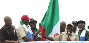 Comrade Oshiohmole presents APC flag to decampee Lawmaker