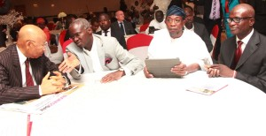"""Lagos State Governor, Mr. Babatunde Fashola SAN (left) discussing with his Osun State counterpart, Ogbeni Rauf Aregbesola (middle) while the author of the book and Commissioner for Information and Strategy, Mr. Lateef Ibirogba (right) watches with admiration during his Public presentation of the book """"Giants of History"""" at the Civic Centre, Ozumba Mbadiwe Avenue, Victoria Island, Lagos, on Tuesday, April 22, 2014."""