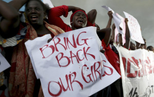 Women react during a protest demanding security forces to search harder for 200 abducted schoolgirls, outside Nigeria's parliament in Abuja