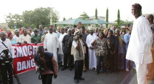 Lagos State Governor, Mr Babatunde Fashola, SAN (right) addressing the crowd during a joint peaceful protest by Lagos and Ekiti House of Assembly members on the purported removal of the Ekiti State's House of Assembly Speaker, Hon. Adewale Omirin, at the Lagos House, Ikeja, on Friday, November 21, 2014.