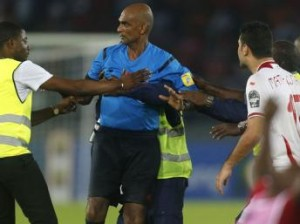 Mr Rajin Draparsad Seechum being Protected by a security official during the controversial match between Tunisia and host of the 2015 African Cup of Nations (AFCON) - Equatorial Guinea.