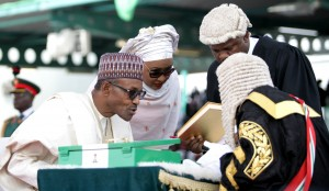 GOODLUCK, BUHARI AND WIFE DURING SIGNING