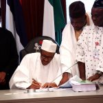 BREAKING: At last, Buhari Signs 2016 Budget into Law