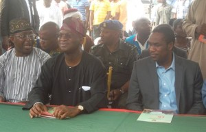 Governor Babatunde Fashola of Lagos State (Middle), Commissioner for Works and Infrastructure, Dr Kadri Obafemi Hamzat (Right) and Mr Bolaji Yusuf Ayinla (Left)