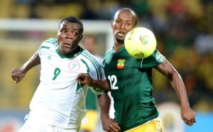 Nigeria's Striker Emenike in white scored 2 goals to dim Ethiopia's world cup dream