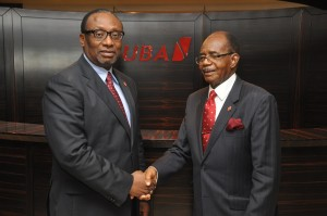 The Outgoing Chairman, Chief Israel Ogbue (right) congratulating the new Chairman, Ambassador Joe Keshi during the meeting of the Board of Directors of United Bank for Africa Plc in Lagos.