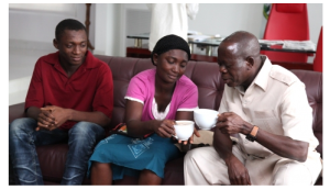 Edo widow Joy Ifijeh drinking team with Gov Adams Oshiohmole