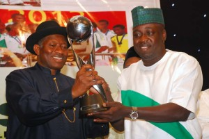 PRESIDENT GOODLUCK JONATHA RECEIVING GOLDEN CUP WON BY THE GOLDEN EAGLETS AT THE THE UAE 2013 FIFA U-17 FROM THE MINISTER OF SPORTS, MALAM BOLA ABDULLAHI DURING A SPECIAL RECEPTION IN HONOUR OF THE GOLDEN EAGLETS OF NIGERIA AT THE PRESIDENTIAL VILLA ABUJA