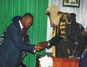 Gov. Chime of Enugu state (L) in a handshake with the Speaker of Enugu House of Assembly